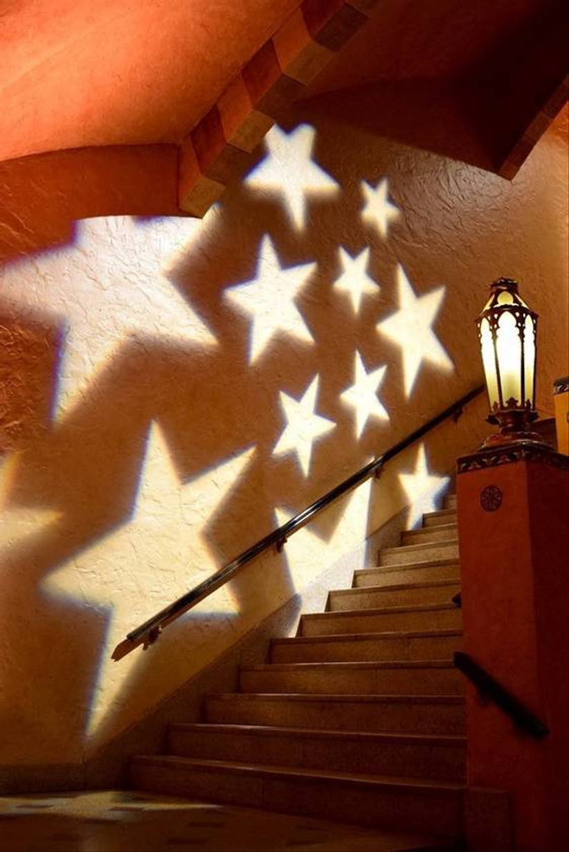 star shapes are projected onto a wall in foyer at wedding venue