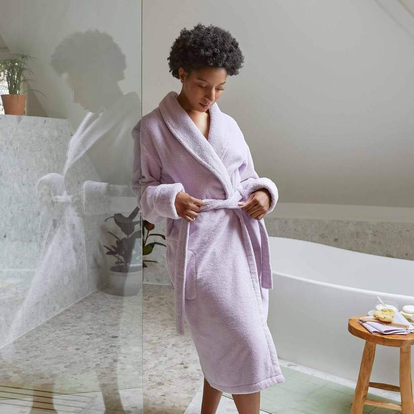 Woman wearing snug purple bath robe
