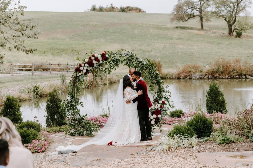 romantic wedding arch circular ceremony backdrop with red and white roses