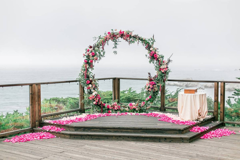 floral arch at oceanfront wedding ceremony space hyatt carmel highlands big sur california