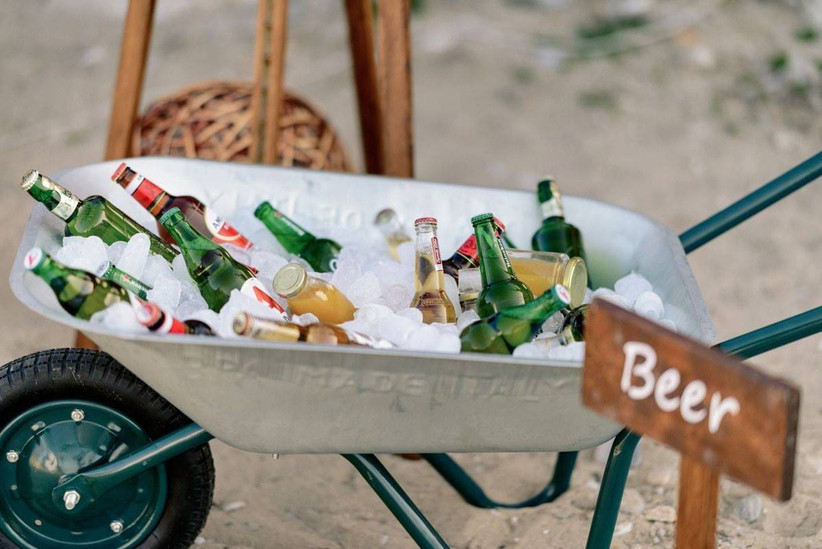 rustic wedding idea wheelbarrow with drinks