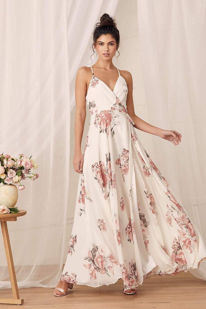 Model wearing cream maxi dress with pink florals