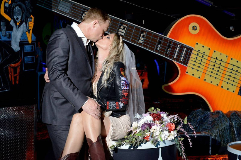 bride and groom kiss at rock and roll las vegas wedding chapel