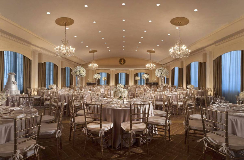 glamorous boston wedding venue hotel ballroom with arched windows, chandeliers and herringbone flooring