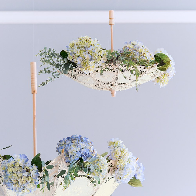 Elegant upside down white lace parasols filled with pretty flowers