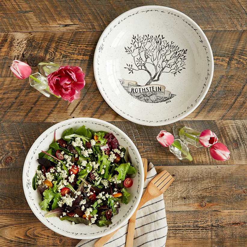 White and black personalized family tree bowl shown empty as well as full of salad