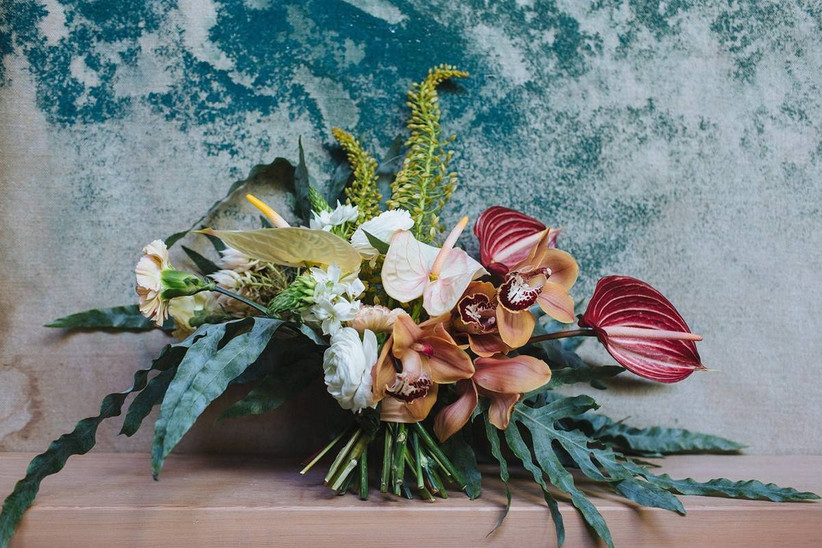 summer wedding bouquets with anthurium, orchids, and greenery