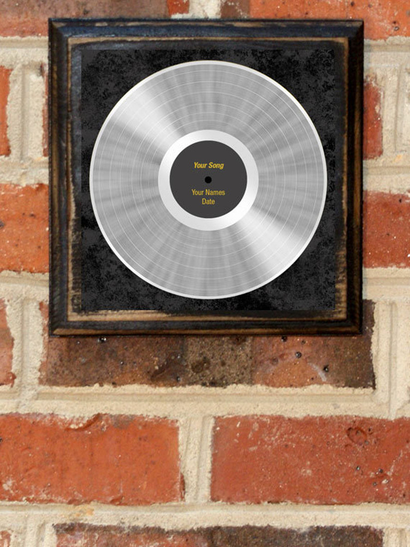 platinum record personalized print hanging on brick wall
