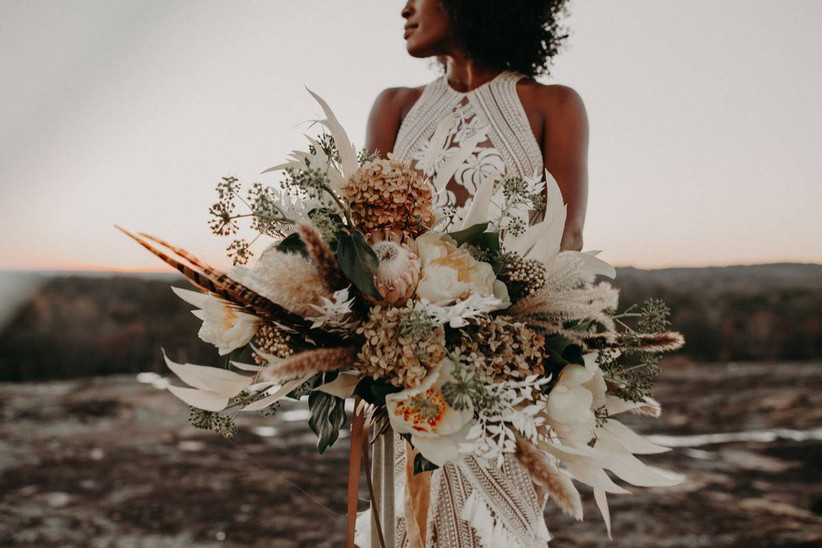 oversized boho protea bouquet with pheasant feathers, dried flowers and greenery