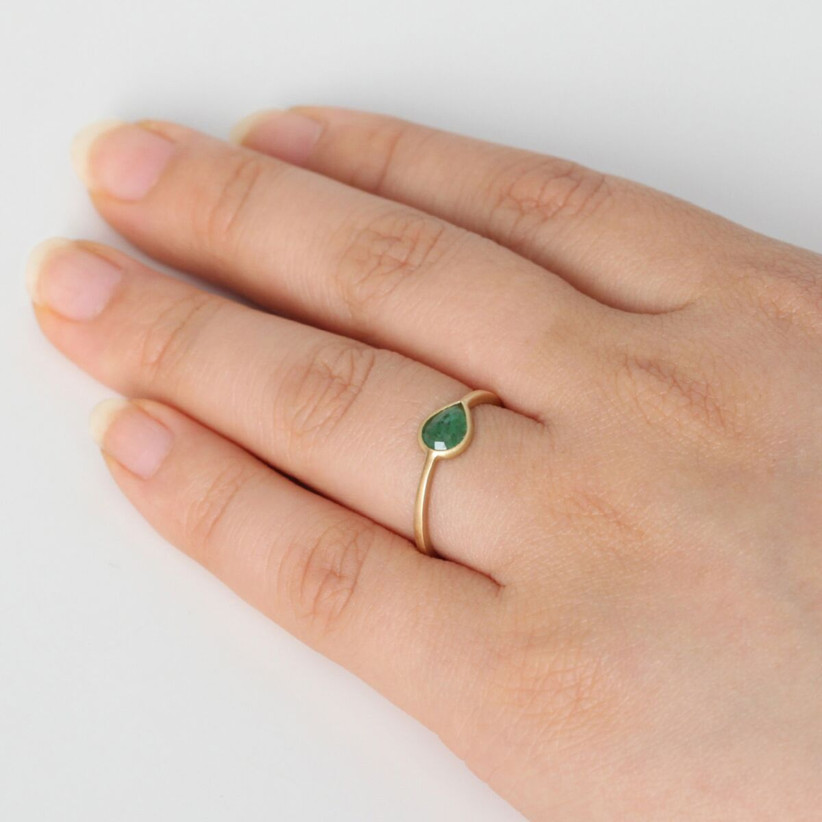 Minimalist rose-cut emerald engagement ring with yellow gold band