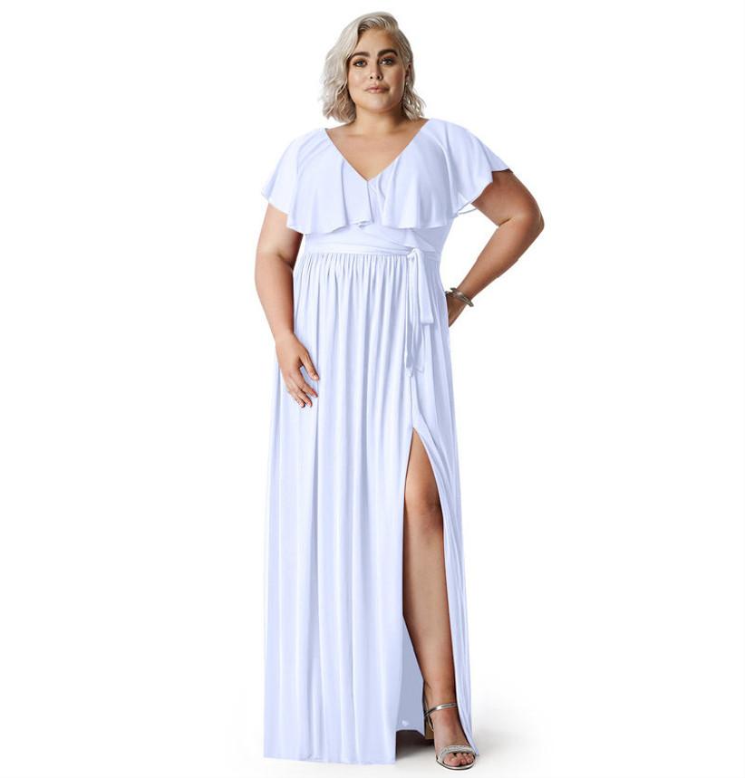 Model wearing ultra-light lavender bridesmaid dress with ruffled neckline and leg slit