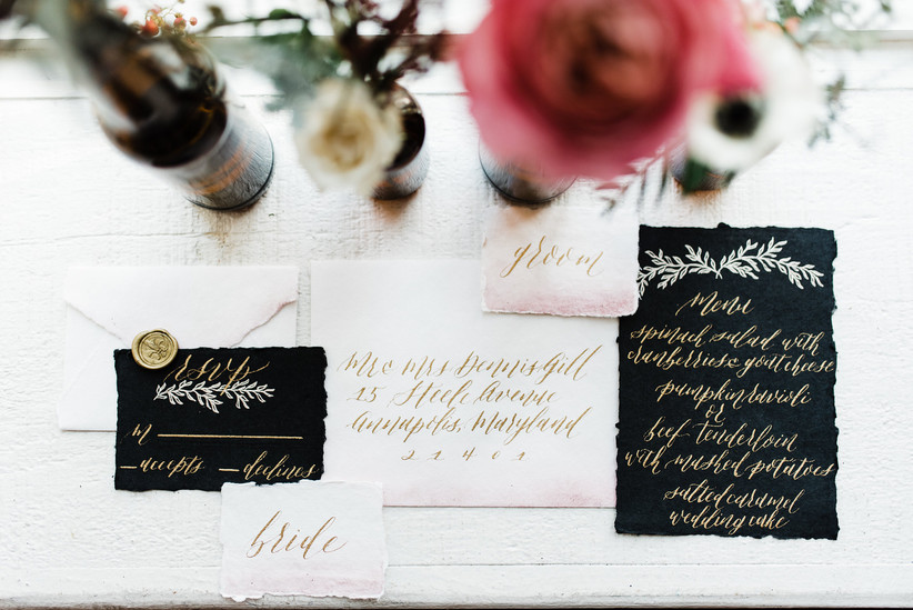 black wedding invitations with gold calligraphy