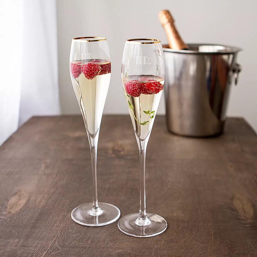 Mr. and Mr. gold-rimmed champagne flutes