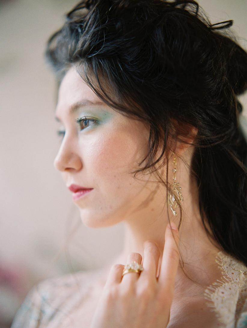 portrait of Asian bride with subtle turquoise eyeshadow