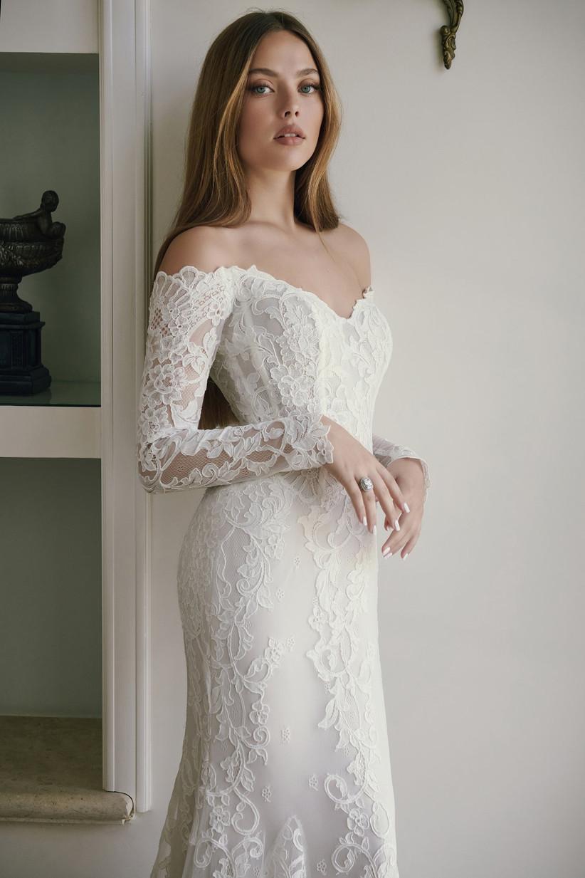 bride wearing off-the-shoulder long sleeve lace wedding dress