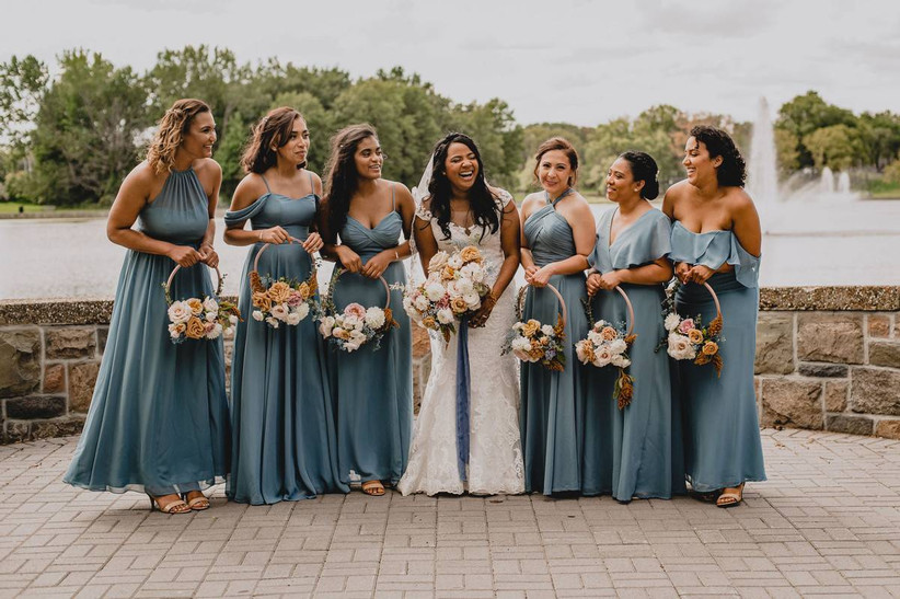 bride with bridesmaids holding floral hoop unique summer wedding bouquets