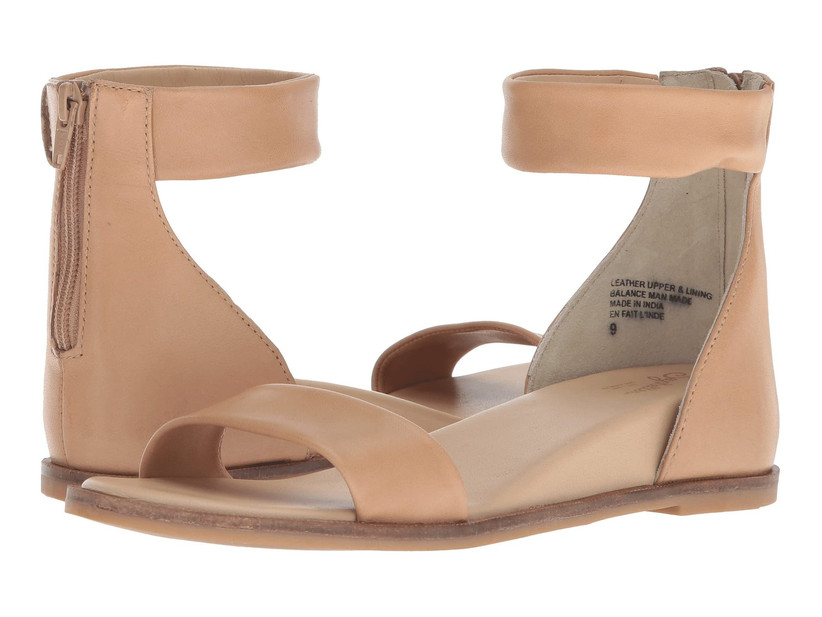 flat tan-colored wedding sandals with ankle strap and zipper closure