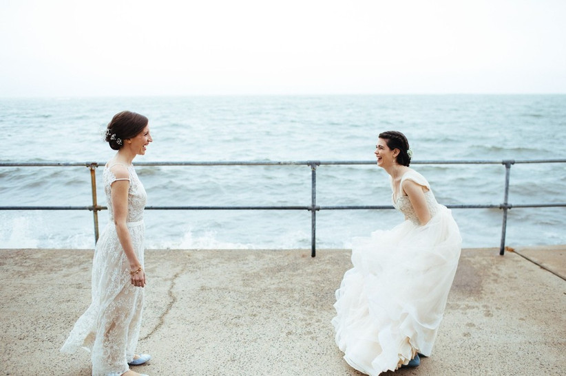 these two brides learned how to plan a wedding so they're having a scenic first look photo together