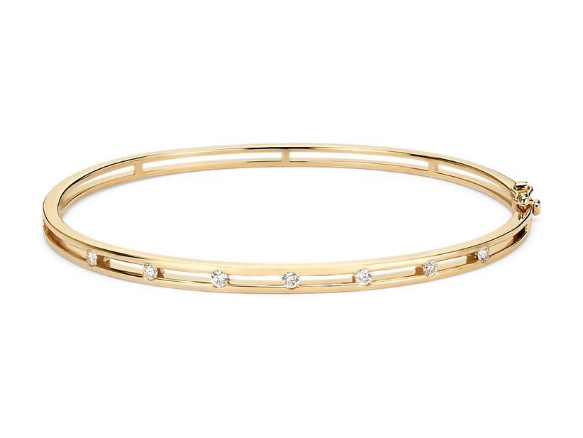 Yellow gold diamond station bangle bracelet traditional 60th anniversary gift