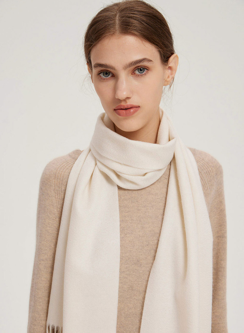 Woman wearing white cashmere scarf