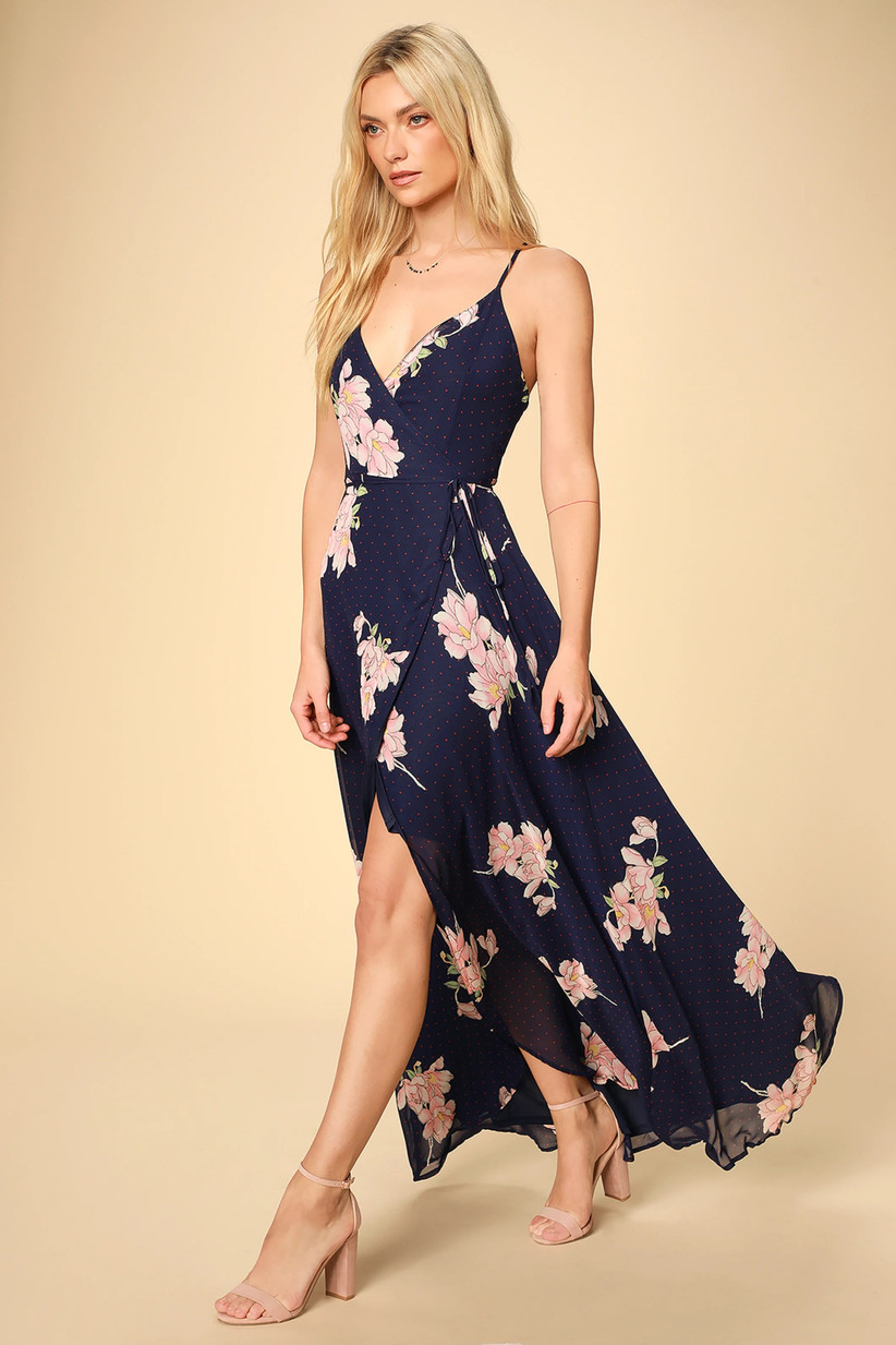Model wearing navy maxi with pink flower print and subtle red polka dots