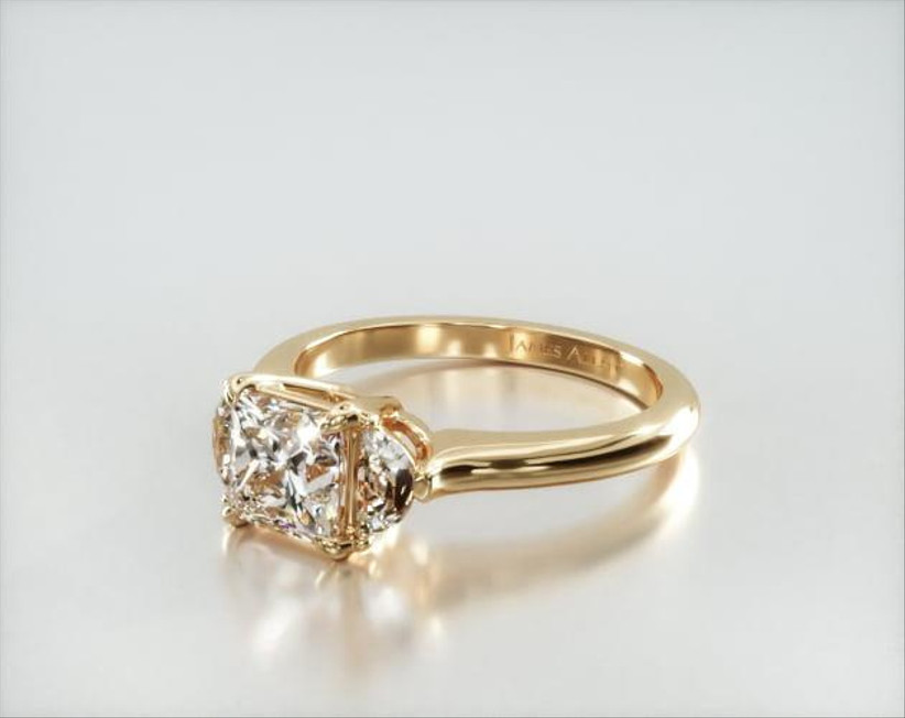 yellow gold three stone engagement ring with princess cut and half-moon stones