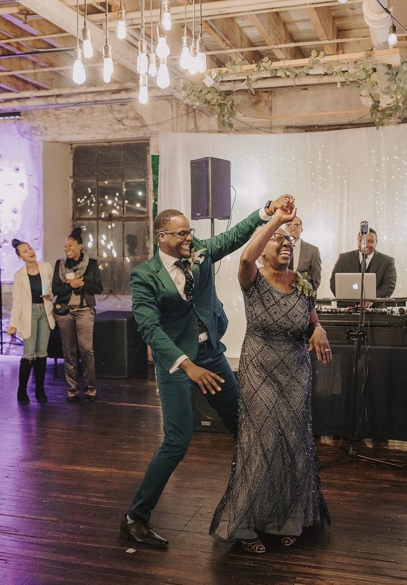 groom twirls his mom on the dance floor