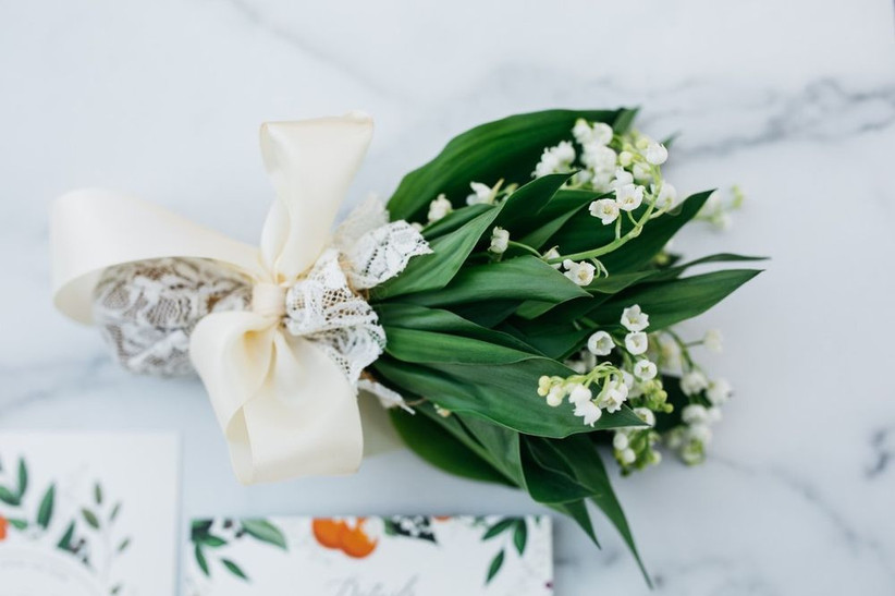 miniature lily of the valley bouquet tied with lace and satin ribbon