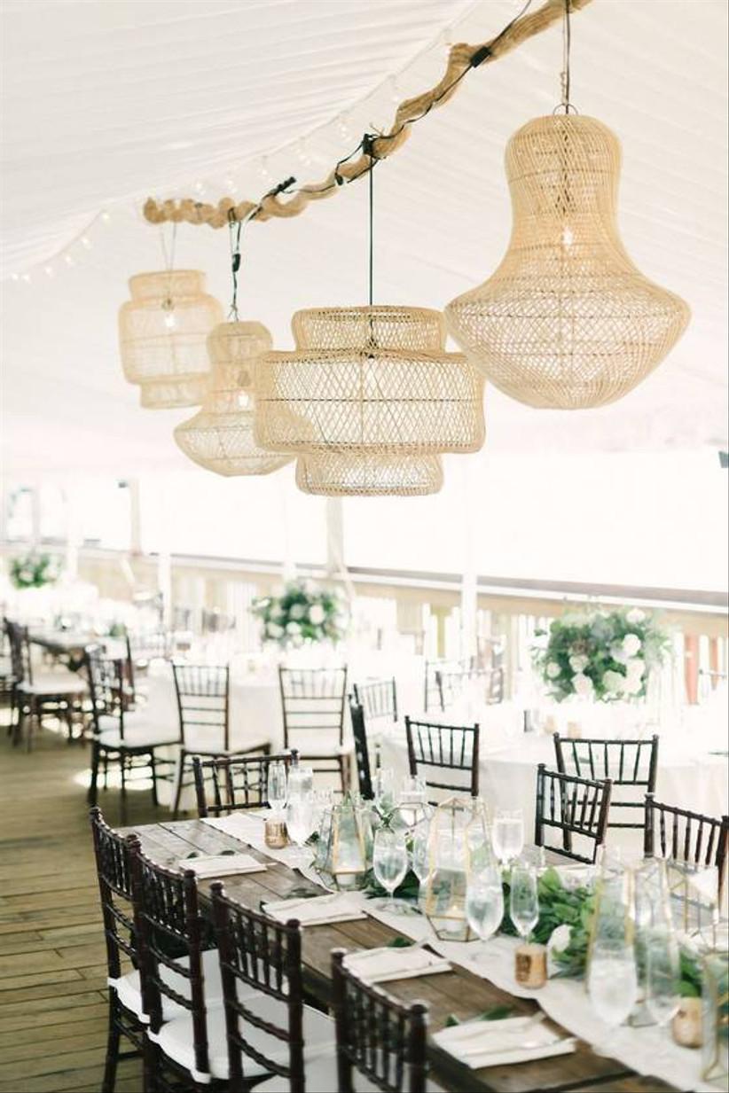 beach wedding reception decor rattan lamps hanging from driftwood chandelier
