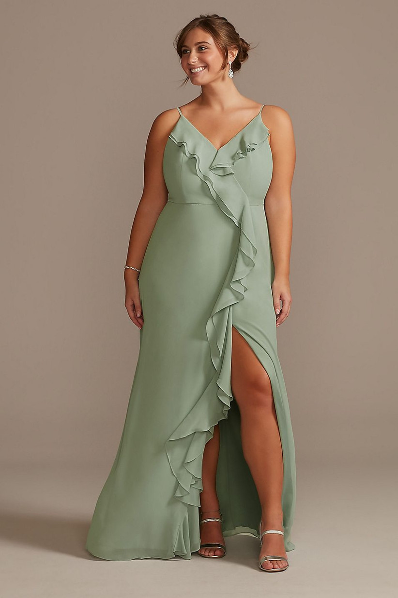 Model wearing pastel green bridesmaid dress with ruffles and spaghetti straps