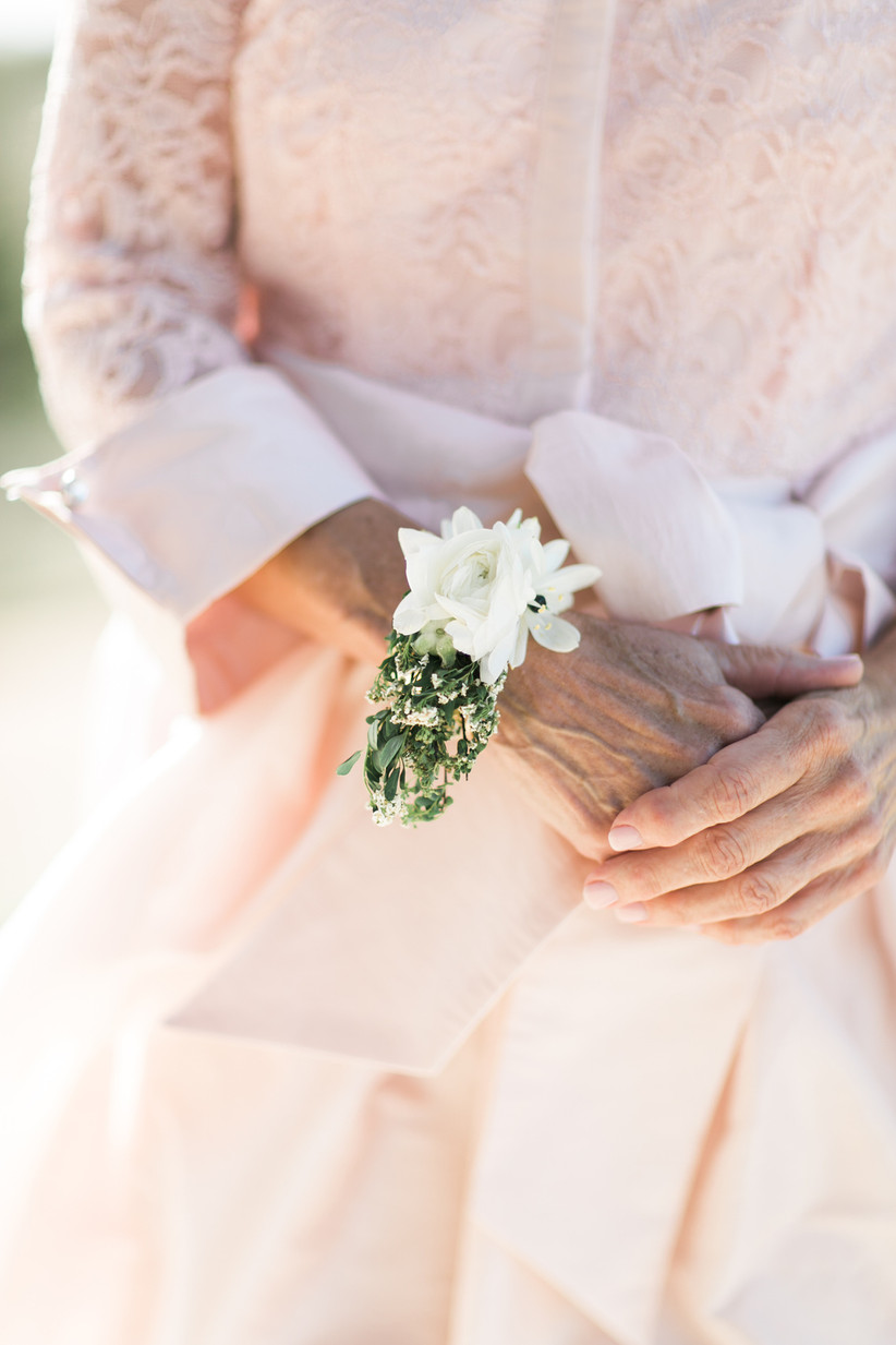 close-up of greenery corsage on wrist of grandmother