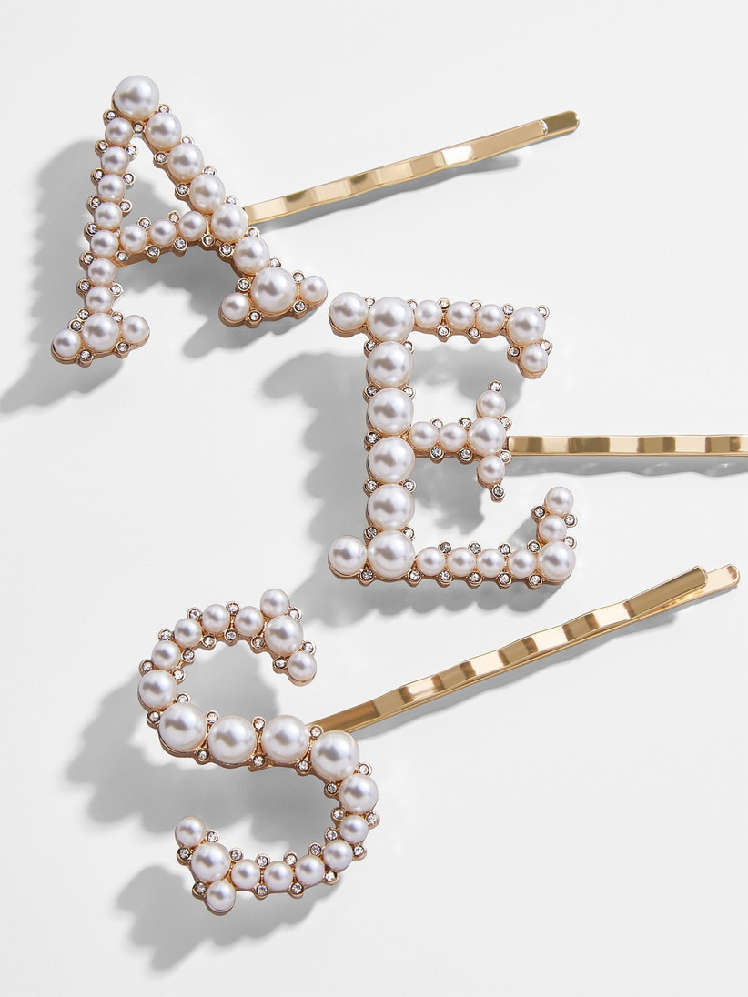 pearl hairpins in the shape of letters