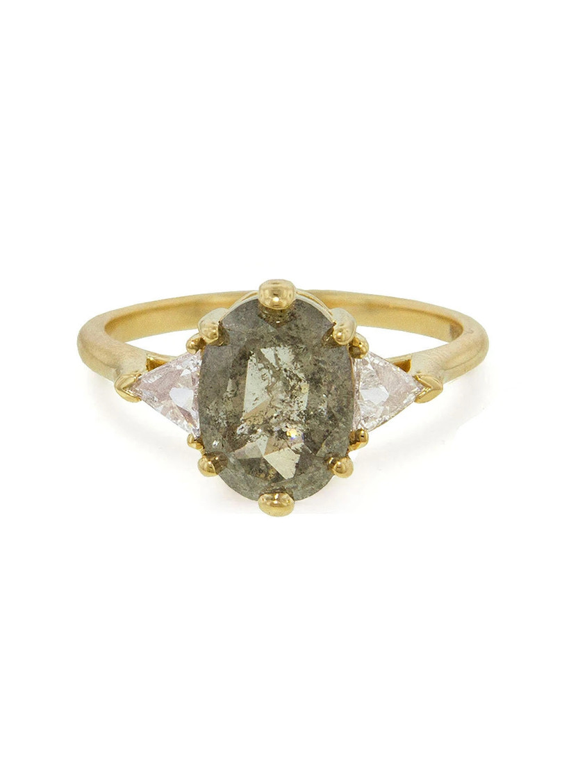 unique three stone engagement ring with oval raw diamond and triangle side stones