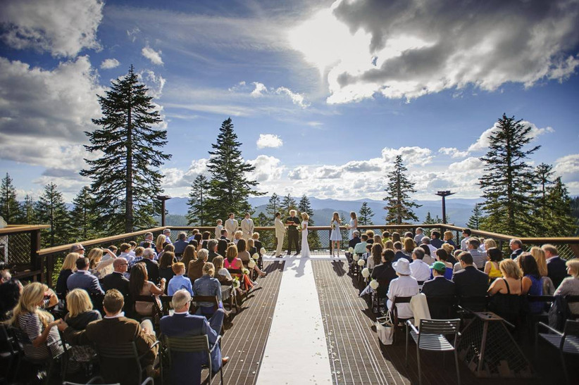 outdoor wedding ceremony on a terrace with mountain and pine tree views