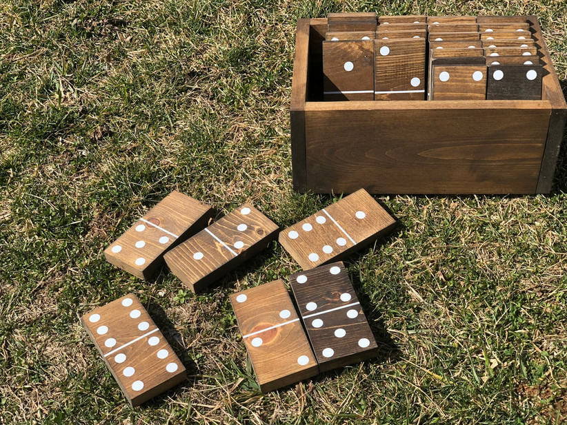 giant wooden dominos and storage crate on grass