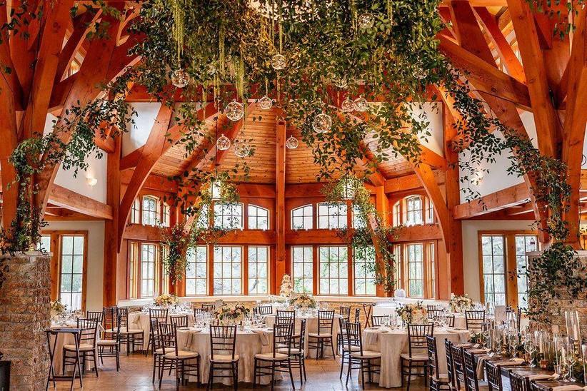 indoor wedding decorated with greenery