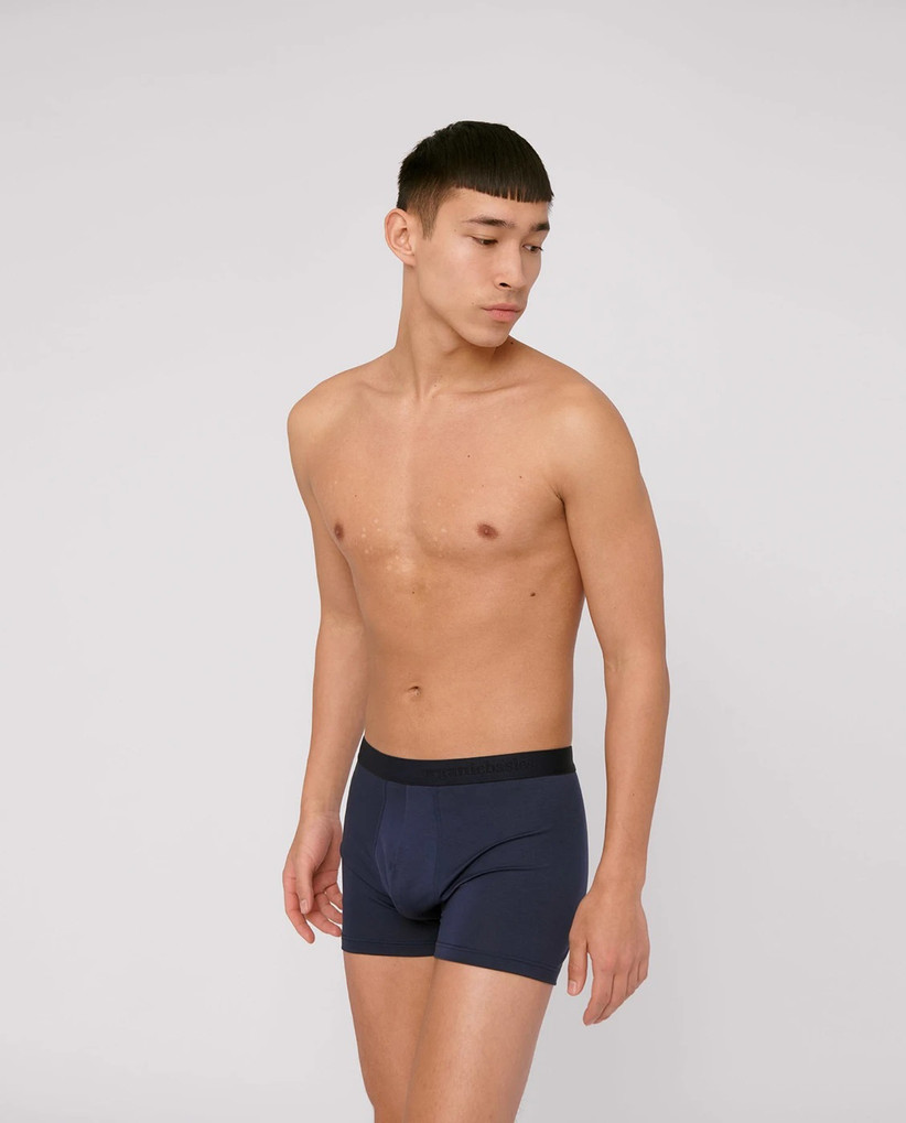 Model wearing navy boxer briefs with black waistband