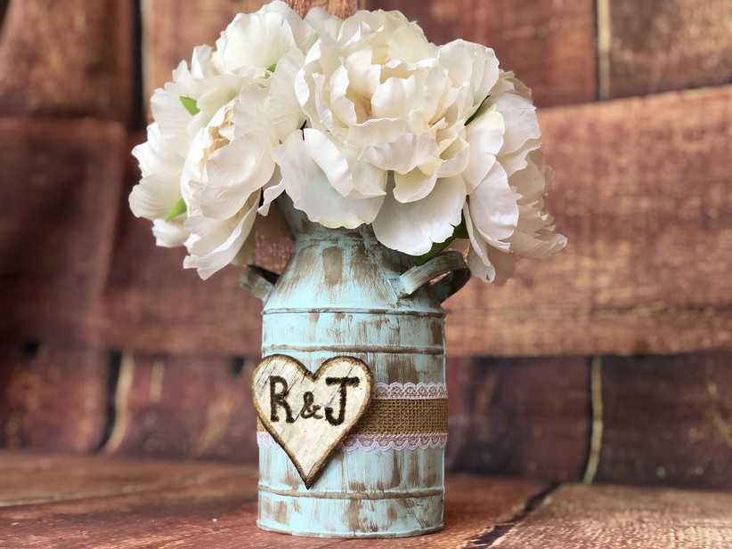 Rustic distressed blue mason jar with custom initial heart, jute ribbon, and white flowers