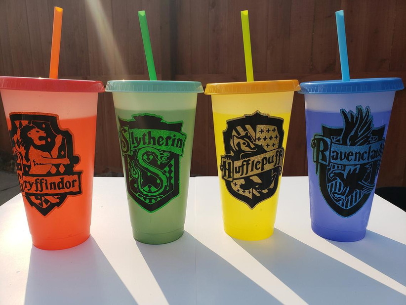 reusable plastic tumbler cups with straws in hogwarts house colors and logos
