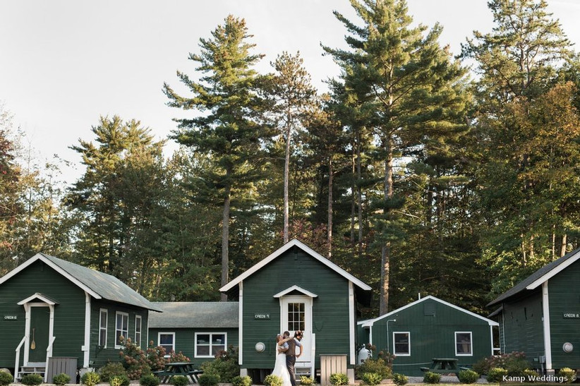 wedding couple standing amidst green bunks a