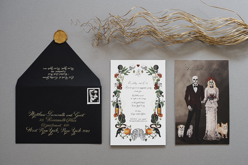 gothic wedding invitations with bride and groom skeletons standing with their skeleton pets