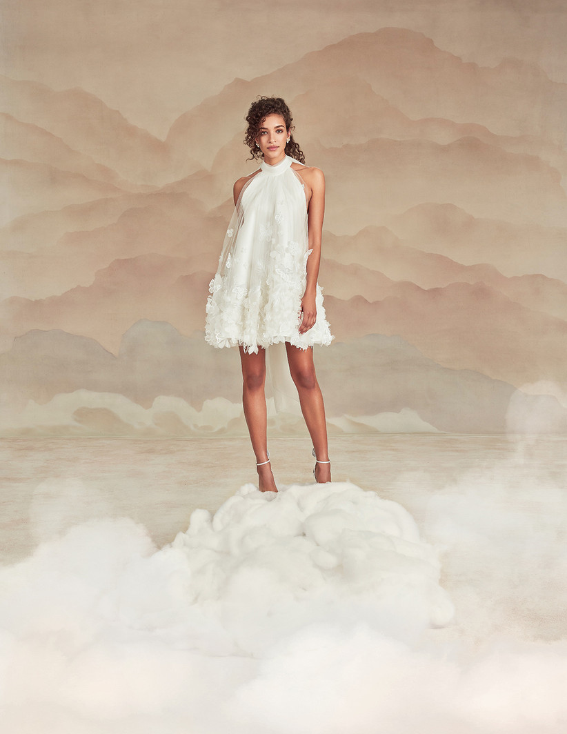 short trapeze silhouette wedding dress with halter neckline and layered skirt