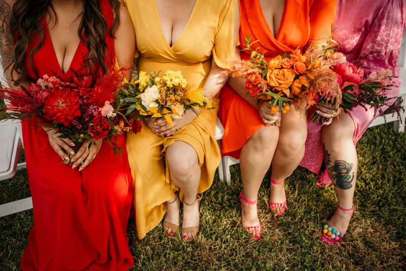 colorful bridesmaid bouquets with pink, yellow, orange, and red flowers