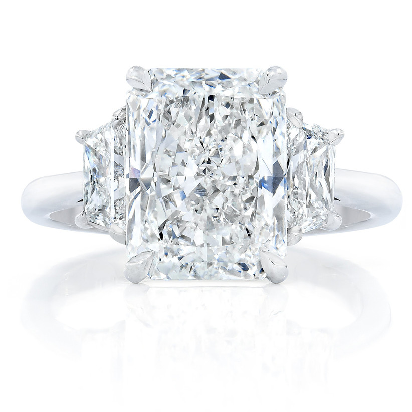 vintage three stone engagement ring with radiant cut and trillion diamonds