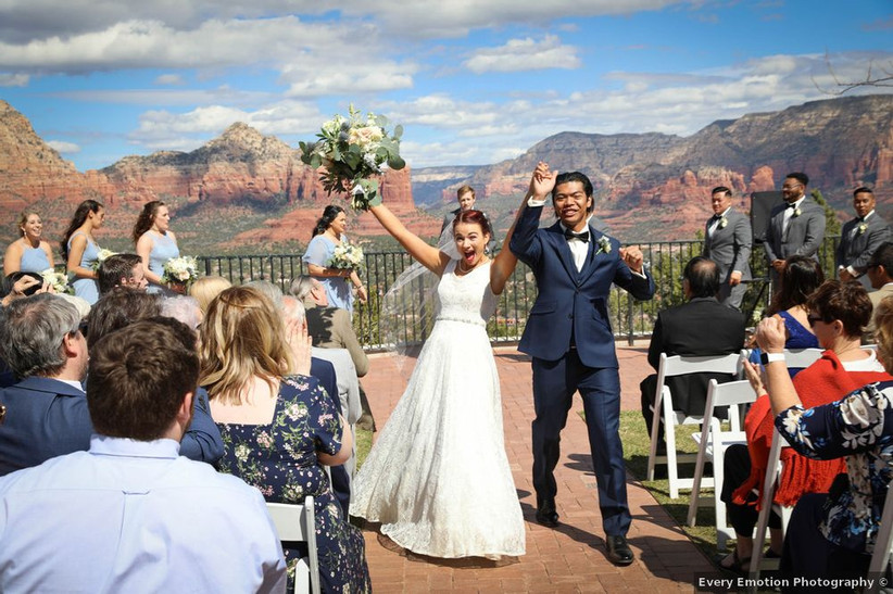 couple just married with sedona mountains as backdrop