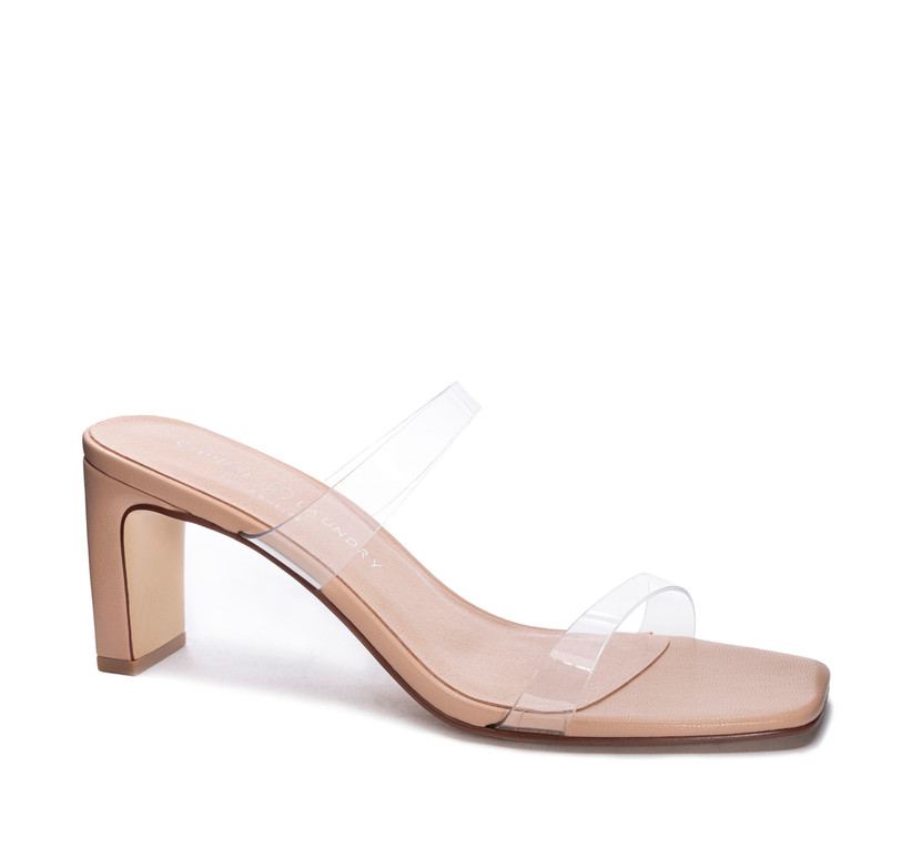 nude slip-on high heel with two clear straps across the top