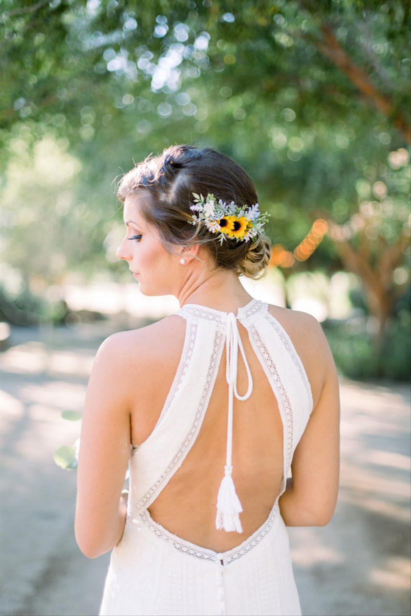 back of bride's hair low chignon with small sunflowers