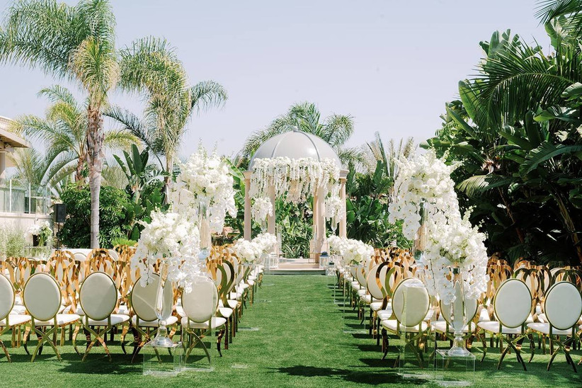 outdoor wedding ceremony decorated with lush white flowers