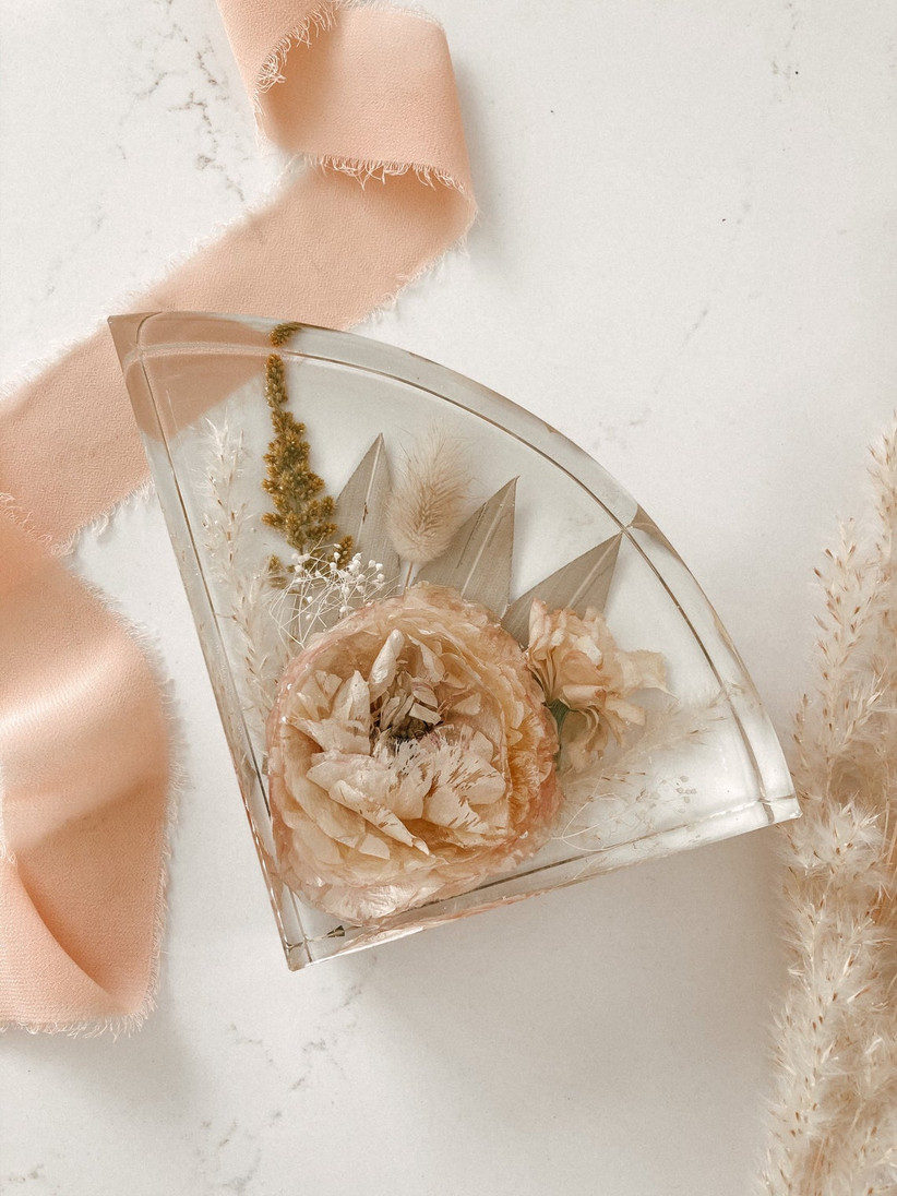 wedding bouquet preservation idea clear resin bookend with dried pressed flowers inside