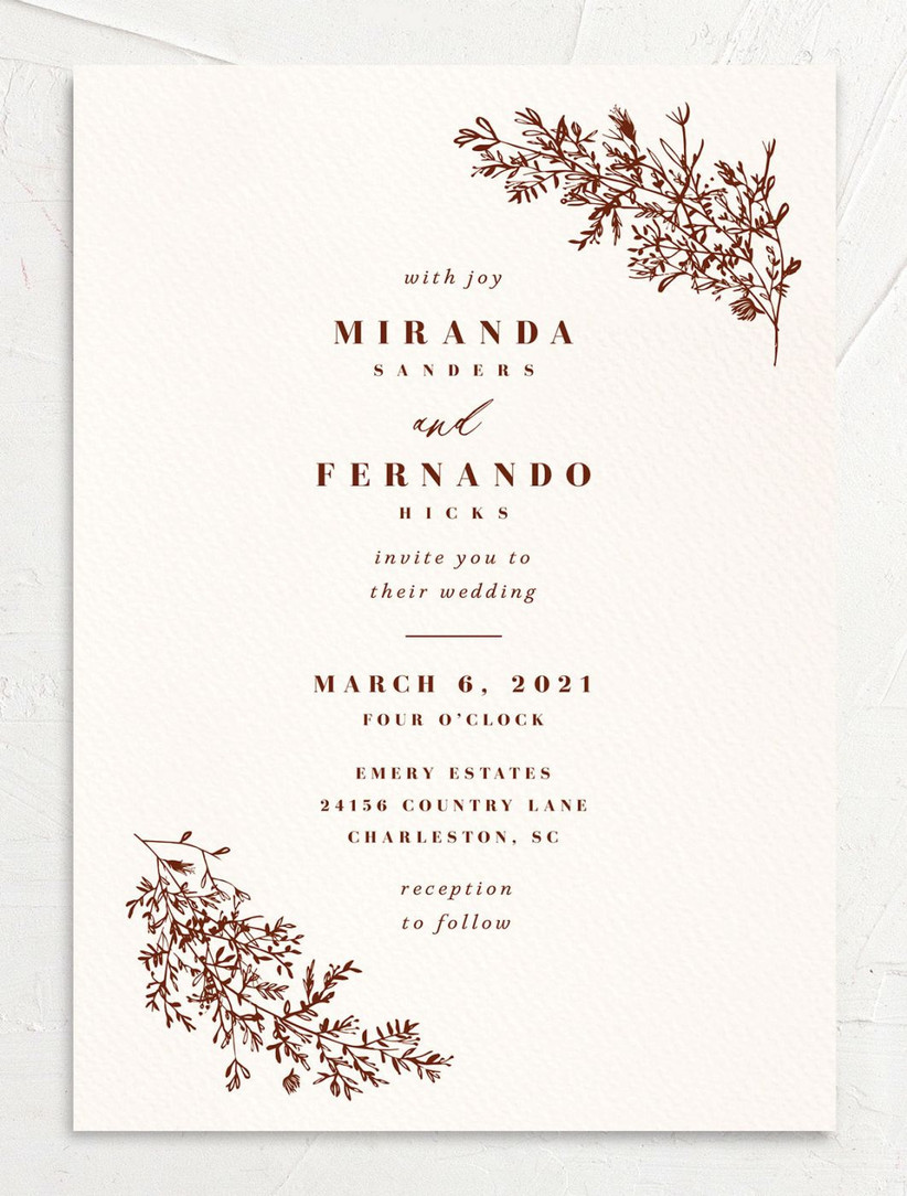 elegant winter wedding invitation with cream background and dark red text with floral pattern in corners
